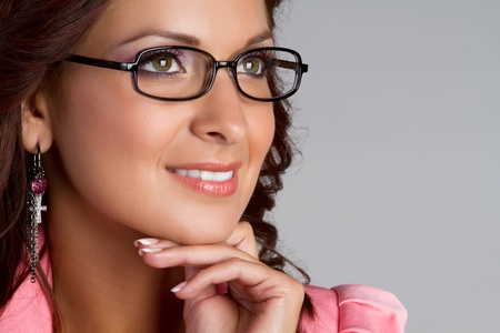 Beautiful thinking woman wearing glasses Stock Photo - 11215897