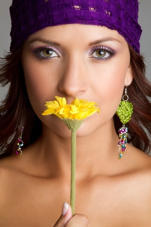 nose close up: Beautiful woman smelling yellow flower