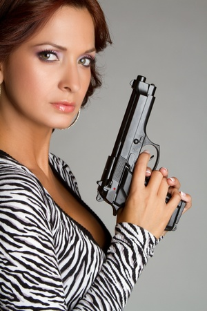gun trigger: Beautiful latin woman holding gun