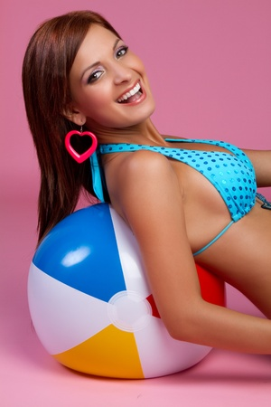 eye ball: Laughing bikini beach ball woman LANG_EVOIMAGES