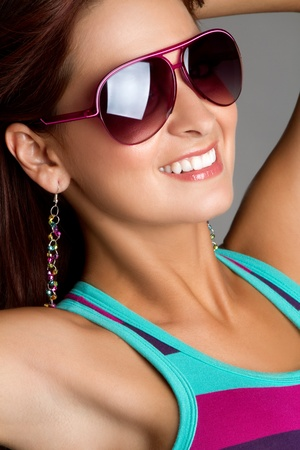 Beautiful smiling woman wearing sunglasses Stock Photo - 11215904