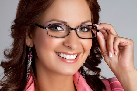 Beautiful smiling woman wearing eyeglasses