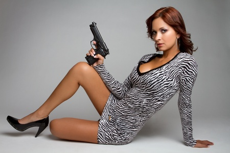 spy girl: Sexy latin woman holding gun