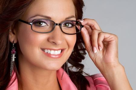 woman wearing glasses: Beautiful smiling woman wearing glasses