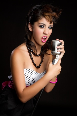 Beautiful singing young hispanic woman Stock Photo - 11215909