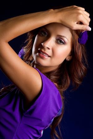 Beautiful latin woman wearing purple photo
