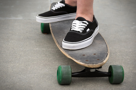 skateboard shoes: Person standing on a skateboard Stock Photo