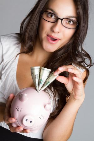 piggy: Business woman taking money from piggy bank