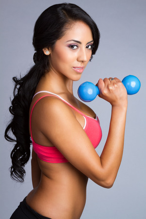 Weights: Latin fitness woman lifting weights