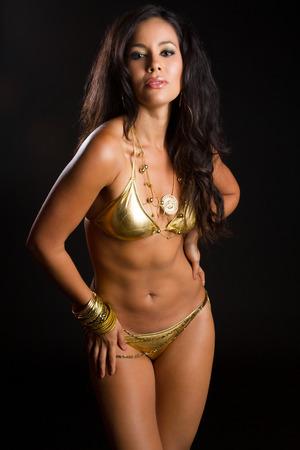 bathingsuit: Latin american woman wearing gold bikini