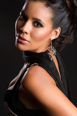 Beautiful latin american woman on black photo
