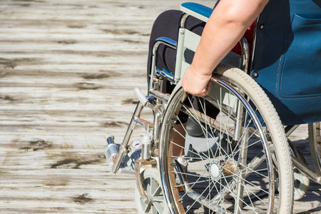 propelled: Woman sitting in self propelled wheelchair
