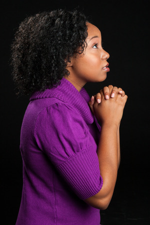 Beautiful isolated african american woman praying photo