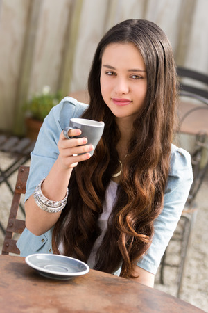 maori: Beautiful young maori woman drinking coffee