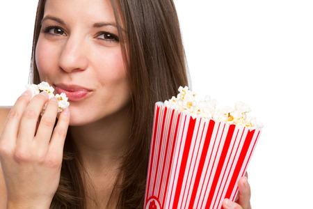 eating popcorn: Beautiful girl eating popcorn on white background