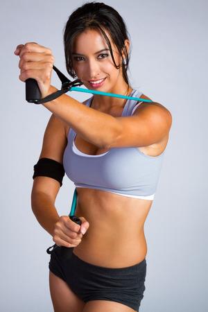 stretchy: Beautiful latin fitness woman exercising