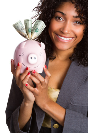 Smiling black woman holding pink piggy bank photo