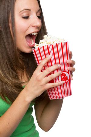eating popcorn: Pretty teenage girl eating popcorn