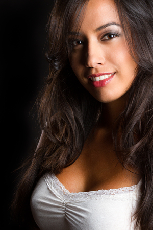 Beautiful smiling young hispanic woman photo