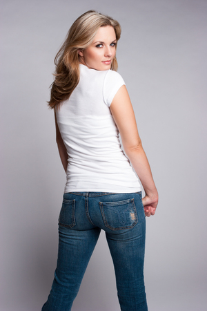 Beautiful blond woman wearing jeans and white tshirt photo