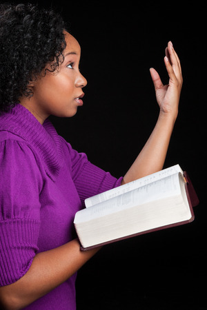 Woman worshipping God holding bible photo