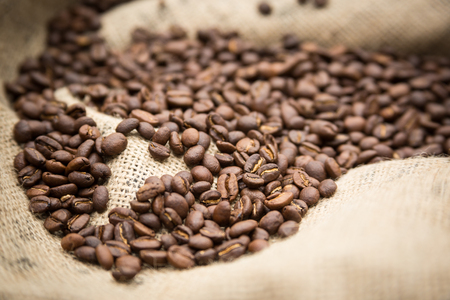 coffee sack: Coffee beans on burlap sack