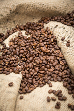 decaffeinated: Coffee beans on burlap sack