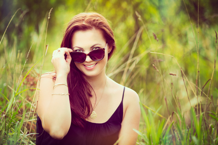 Woman in the grass wearing glasses