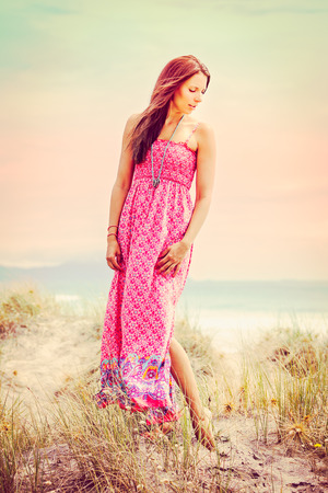 Beautiful fashion model woman at the beach Stock Photo