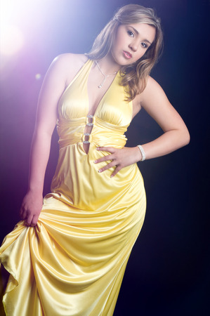 Beautiful latin woman in yellow dress Stock Photo