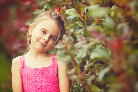 Pretty little girl smiling with vintage filter