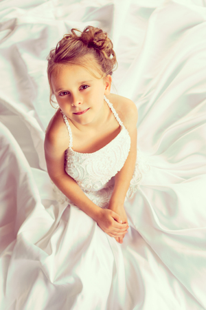 bride dress: Pretty little girl wearing wedding dress