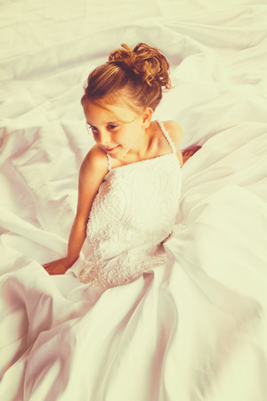 Beautiful young child bride in wedding dress Stock Photo