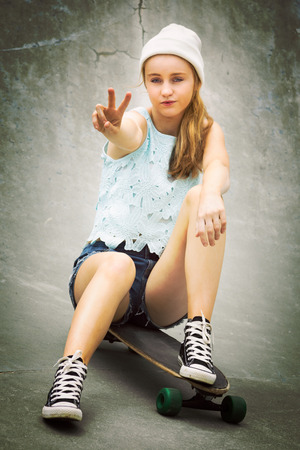 board shorts: Skater girl showing peace sign