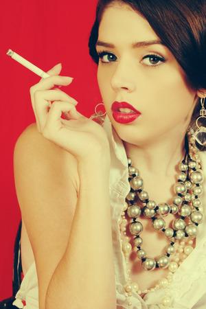 sexy girl smoking: Beautiful woman smoking a cigarette