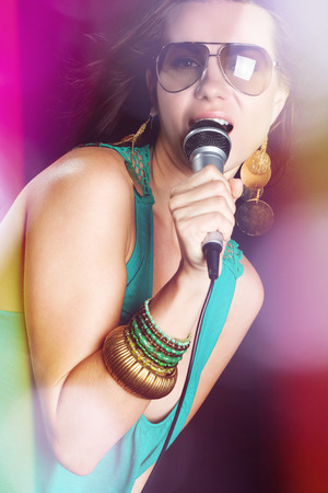 Female singing with coloured lights photo