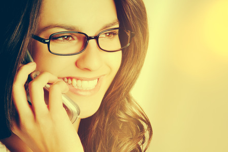 woman  glasses: Smiling woman talking on mobile phone