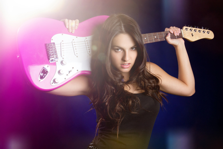 Rock star girl holding guitar photo