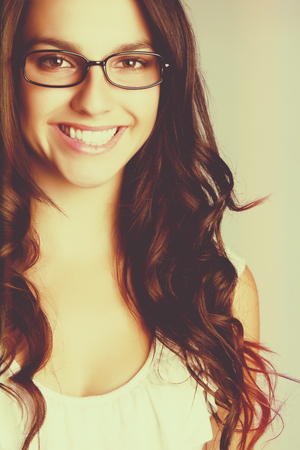 Beautiful smiling woman wearing glasses photo