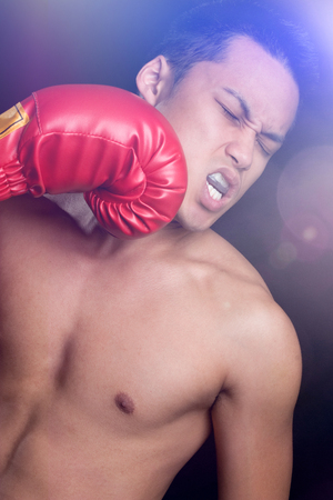 punched: Male boxer getting punched in the jaw