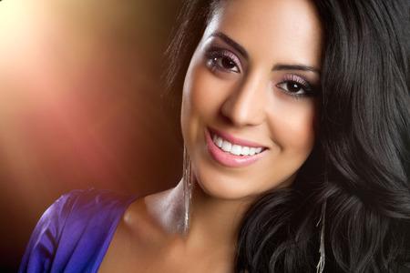Beautiful young smiling hispanic woman