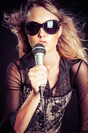 Beautiful rock star woman singing Stock Photo