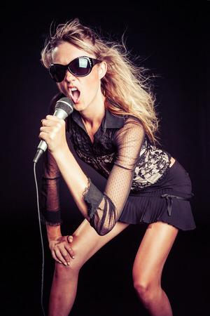 Beautiful pop star girl singing