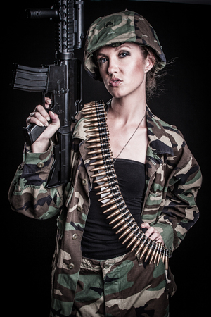 Military army woman holding gun photo