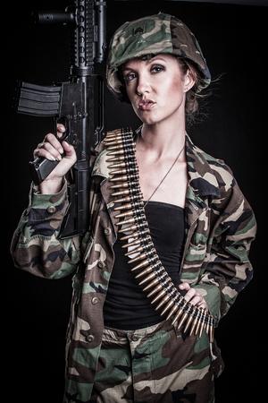 Military army woman holding gun Stock Photo