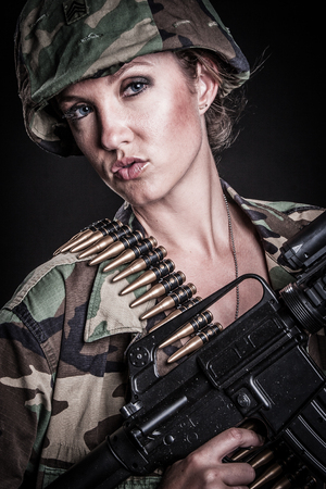 Sexy female soldier with rifle Stock Photo