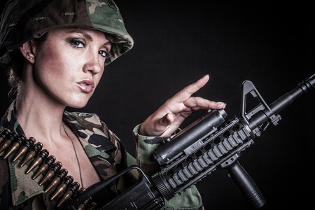 Beautiful sexy female soldier with gun Stock Photo