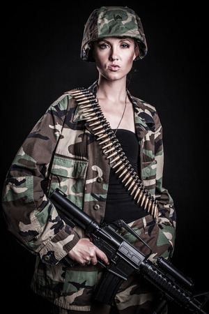 Woman soldier with machine gun