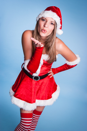 Beautiful Christmas Woman Blowing Kiss