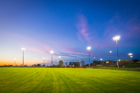 Baseball field with lights at sunset